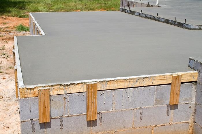 Concrete foundation built on top of cinder blocks.