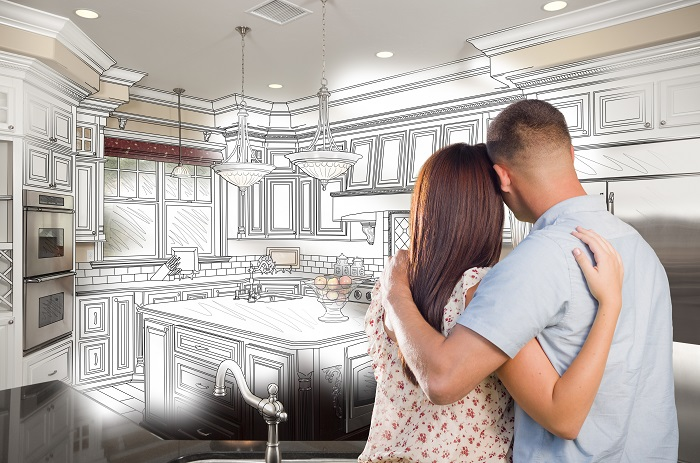 Couple looking into an imaginary kitchen they would like to build.