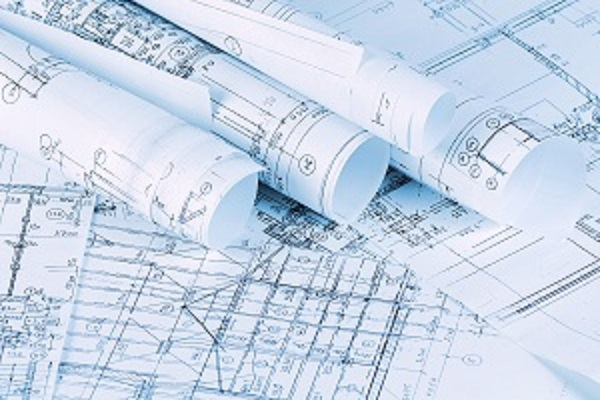 Several sets of blueprints, some flat, some rolled up.